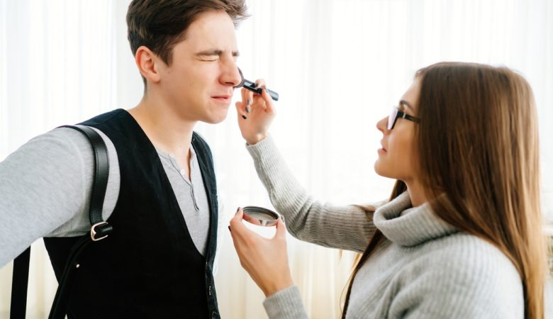 Young woman doing makeup t